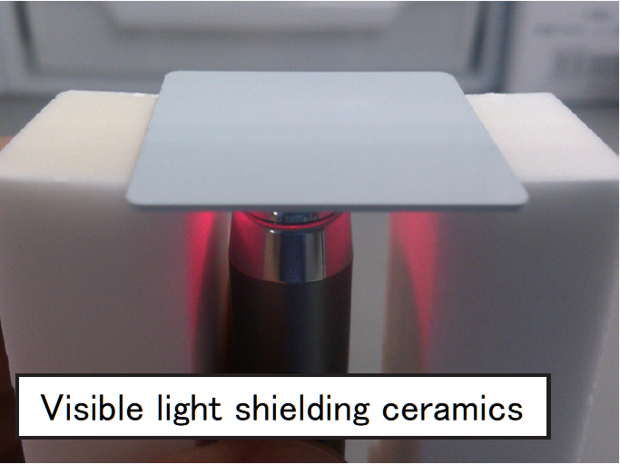 Picture of light shielding ceramics exposed to laser light
